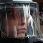 Close up of a soldier in protective helmet symbolizes government