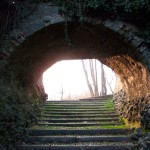 Stairs lead to through a tunnel symbolic of the road to well-being